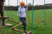 low level ropes course girl zig zag crossing